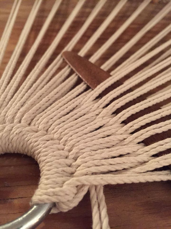 weaving tool separating strands of a hammock chair