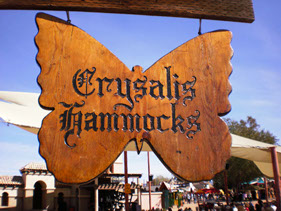 Crysalis Hammocks hand-carved wood sign at a show