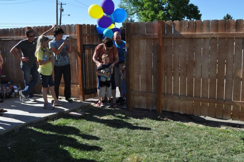 Make a wish. Child being introduced to tiny home project.