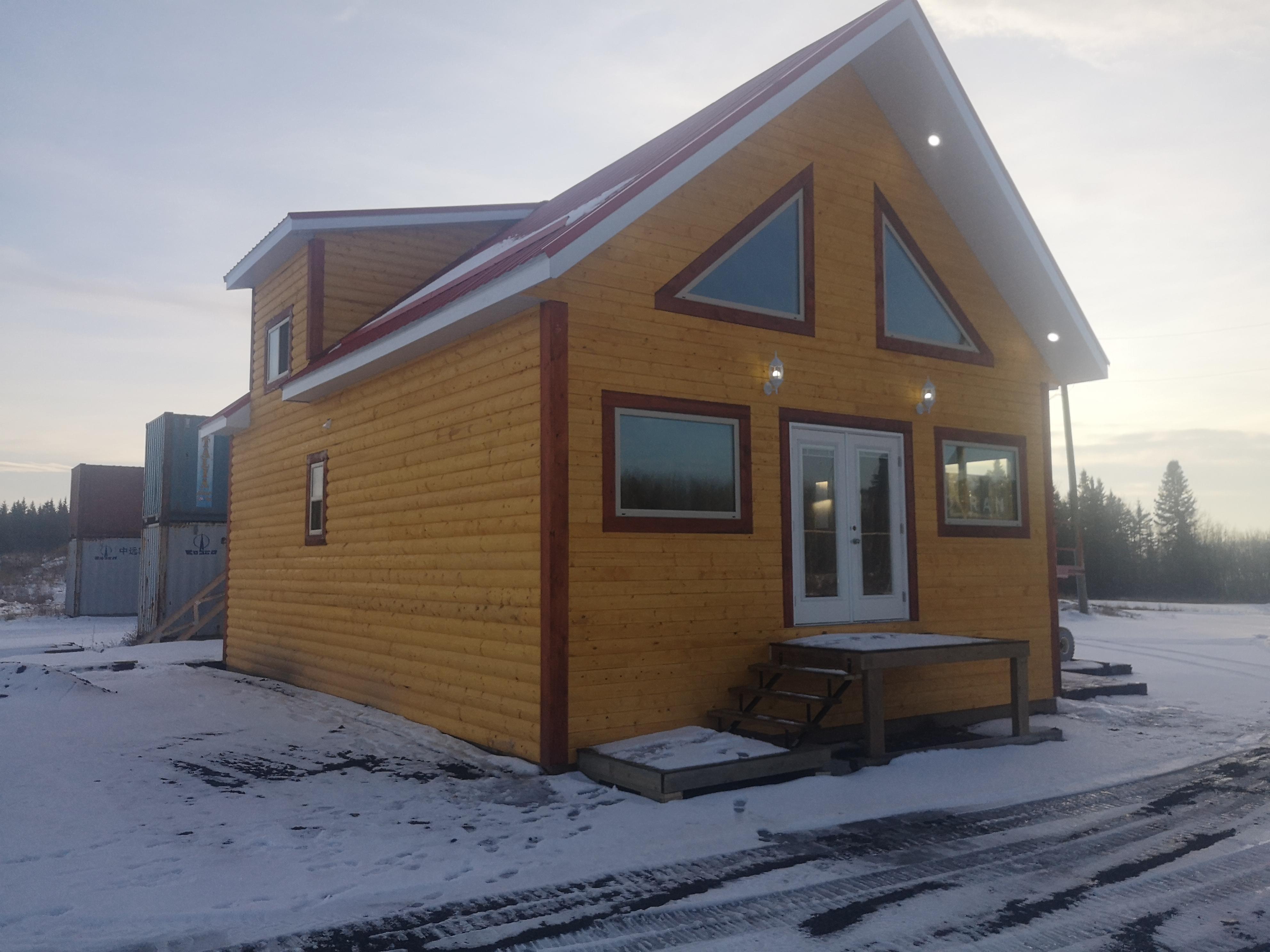 woodland cabin snowy