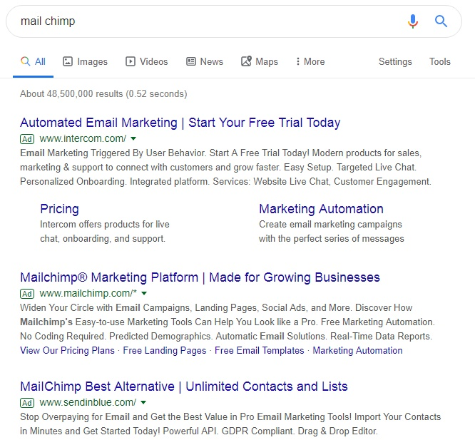 This shows MailChimp are being outbidded by Intercom for their brand name in Google search.