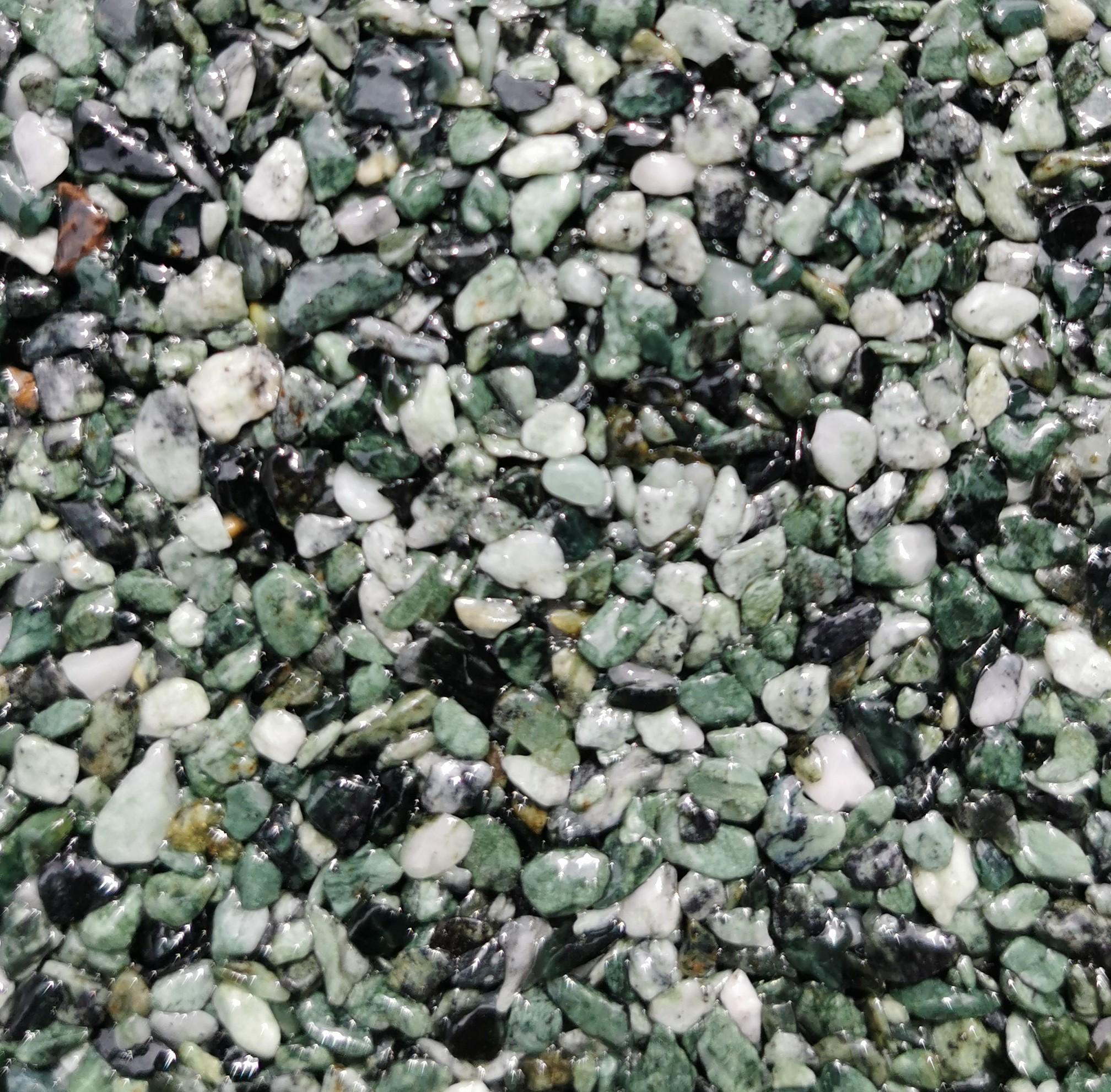 Ein weiß-grünes Steinteppich-Muster