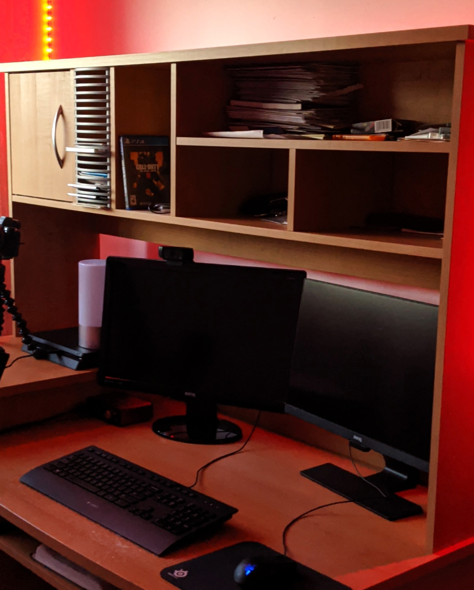 Vinit's office setup with red LED lights shining over a 2 monitor setup