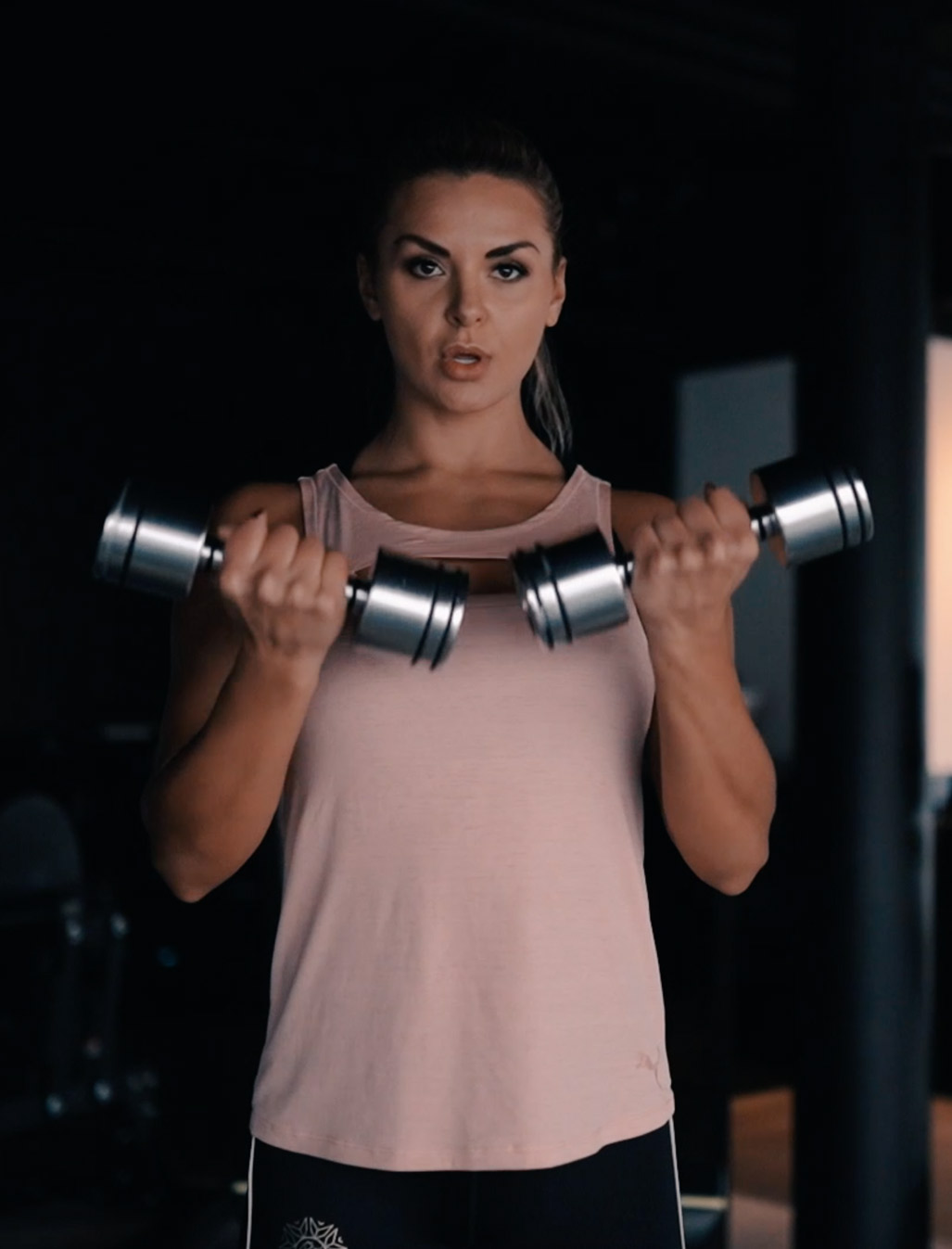 Julia working out with dumbbells