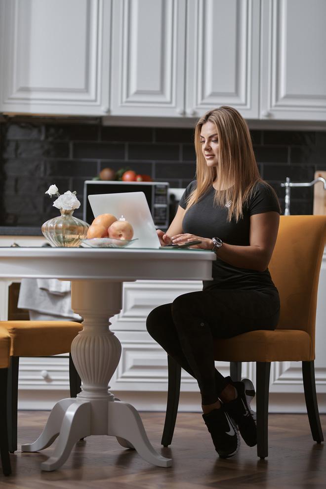 Julia having a conversation with a client over a laptop