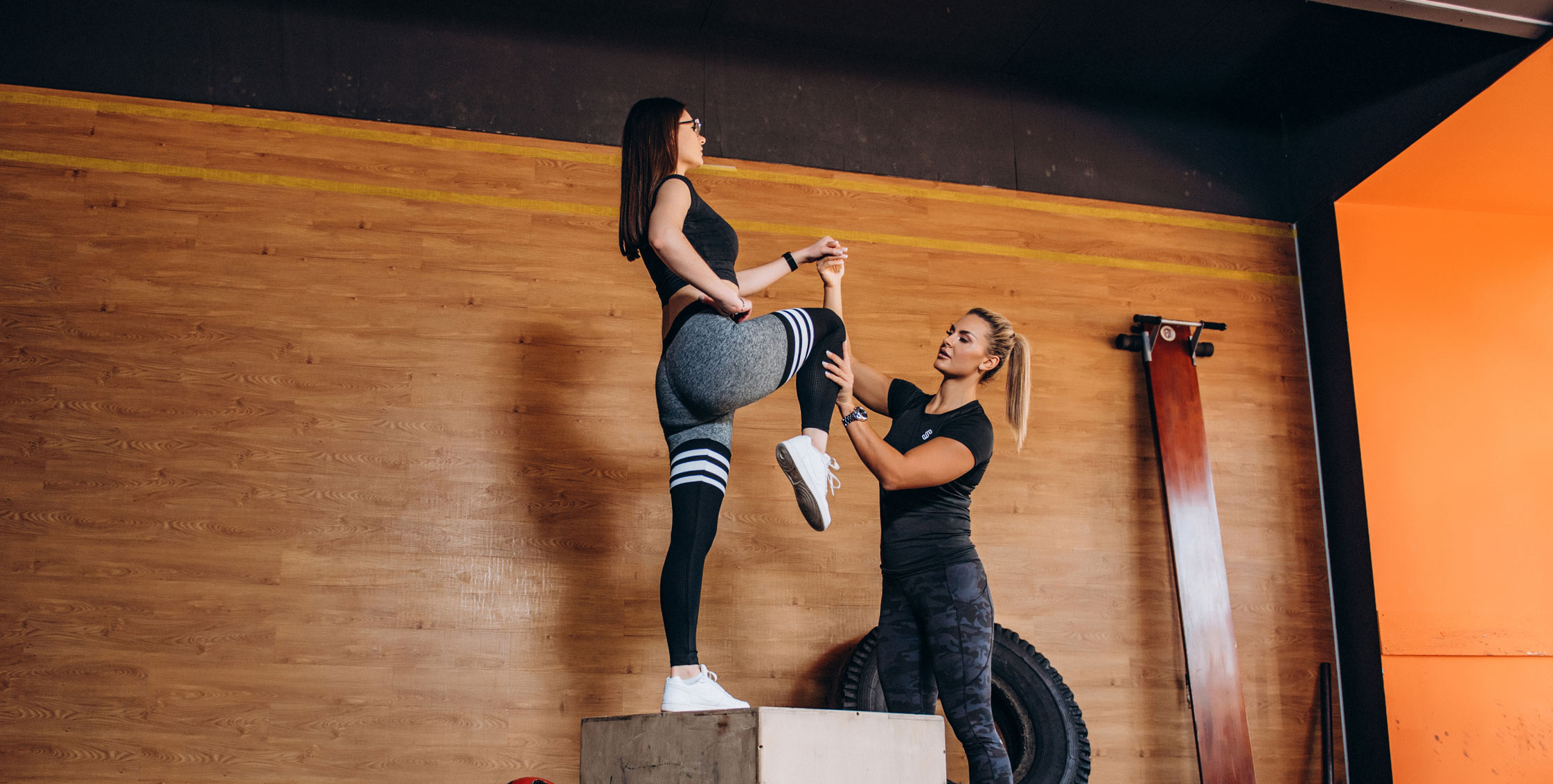 Julia and her client doing a fitness exercise as a part of the personal training program
