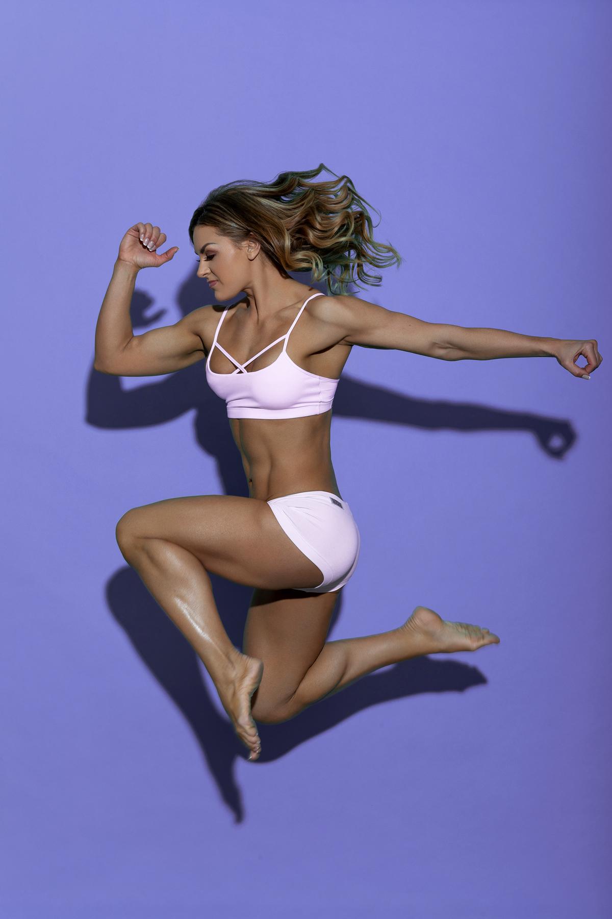 Julia Stecher jumping in sports wear