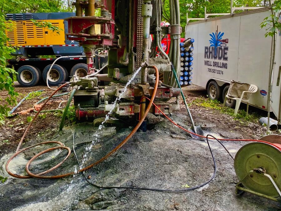 Hydrofracturing a well in Sudbury, Ontario with well drilling equipment.