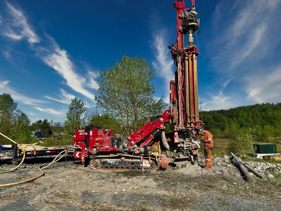 A water well being drilled by a Rhude Well Drilling rig on a beautiful sunny day.
