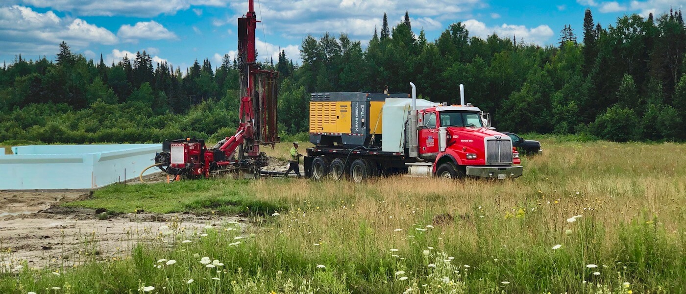 Rhude Well Drilling equipment and technician drilling a water well.