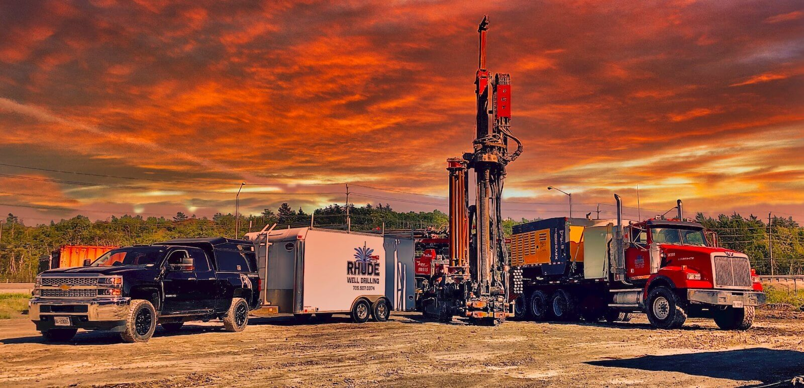 Rhude Well Drilling fleet with a dramatic sunset.