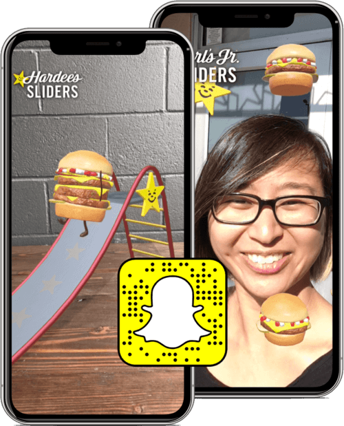 Two mobile phone frames showing a woman using the Hardee's Sliders Snapchat lens, with an overlaid Snapcode