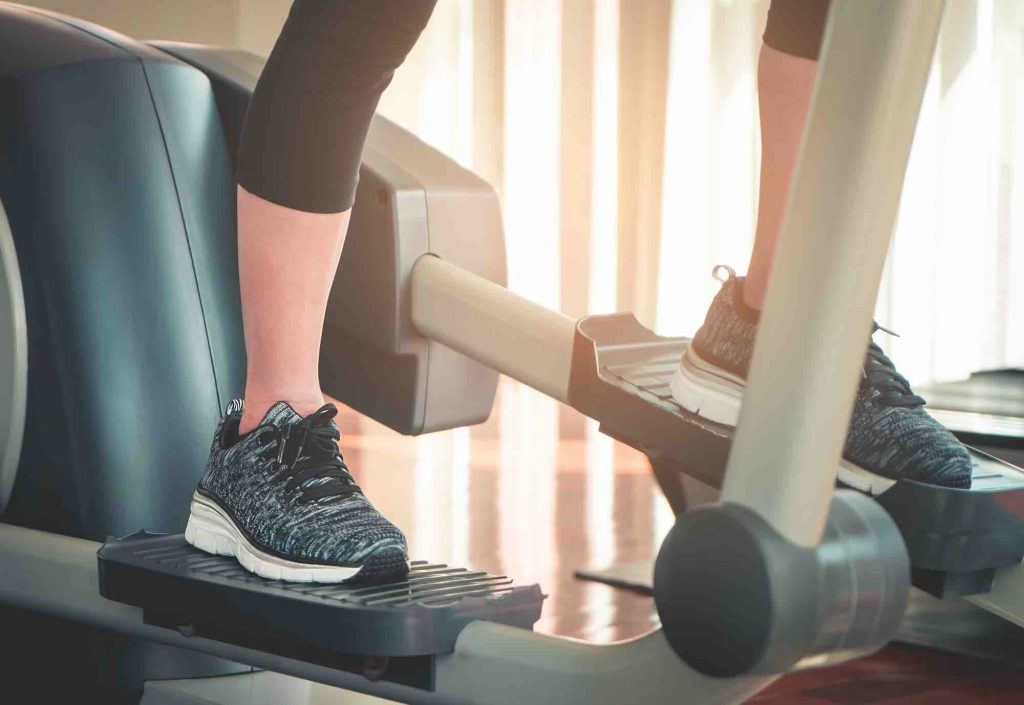 Woman working out on a stairclimber machine