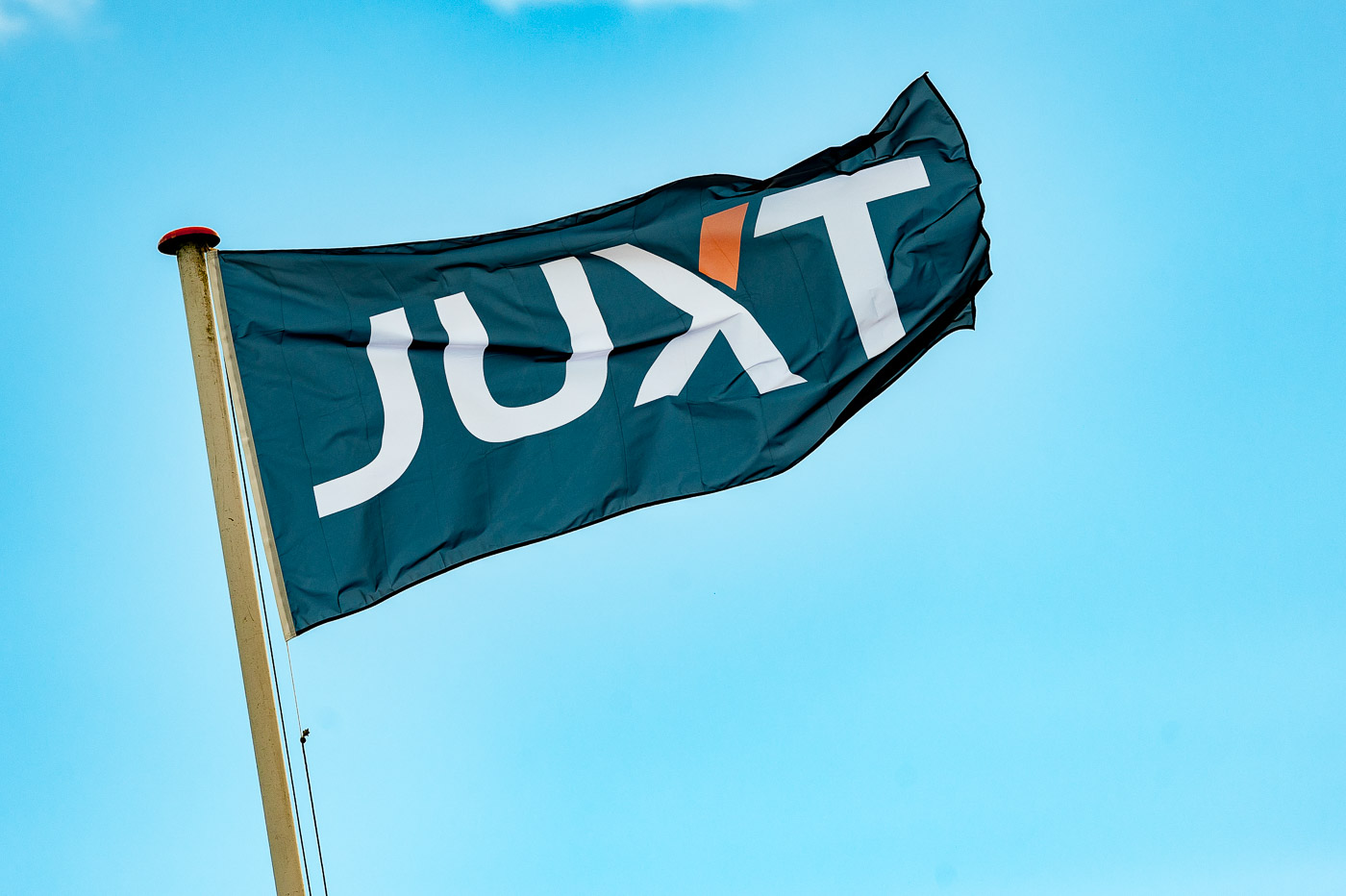 The JUXT flag flying proudly