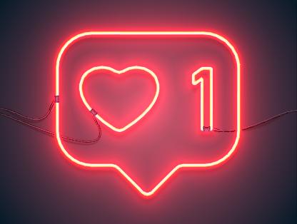 Social like image - Red neon heart image in speech bubble.