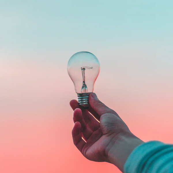 person holding a lightbulb