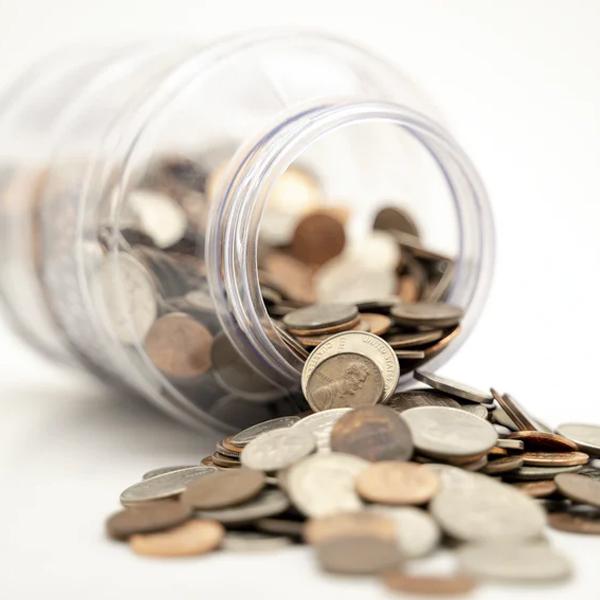 jar of coins fallen over