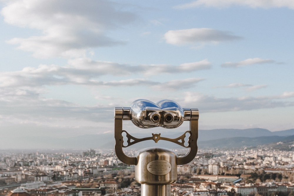 a tower viewer facing a city