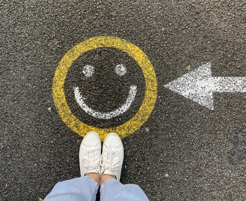 smiley face on the pavement