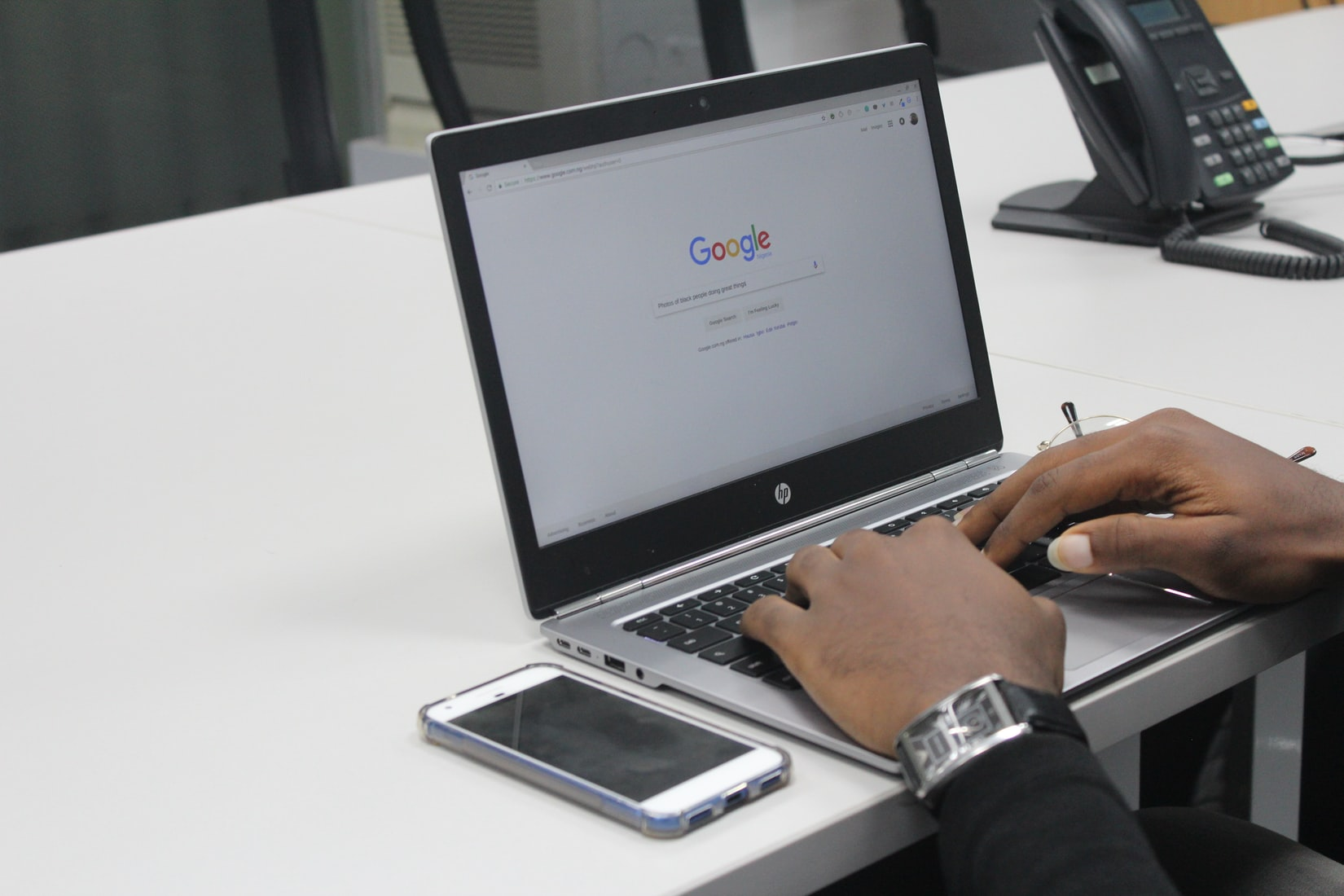 person going on Google on their laptop