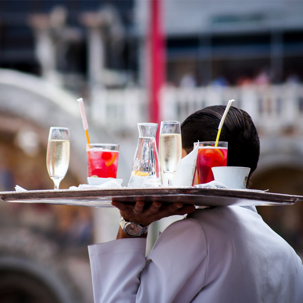 waiter holding a tray of drinks