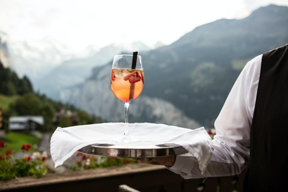 waiter holding a beverage