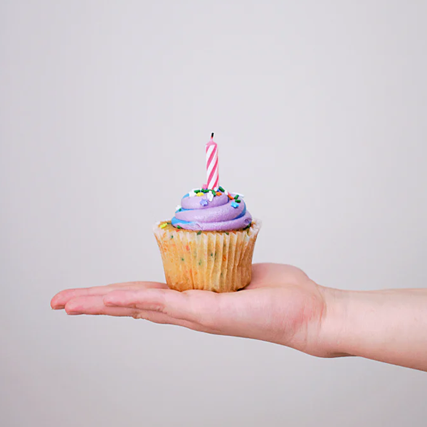 person holding a cupcake