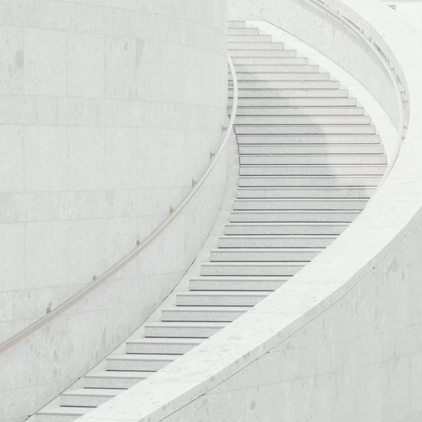 curve in white marble stairs