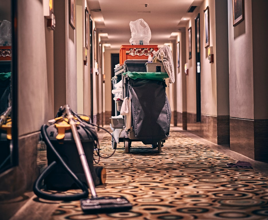 cleaning supplies in a hotel hallway