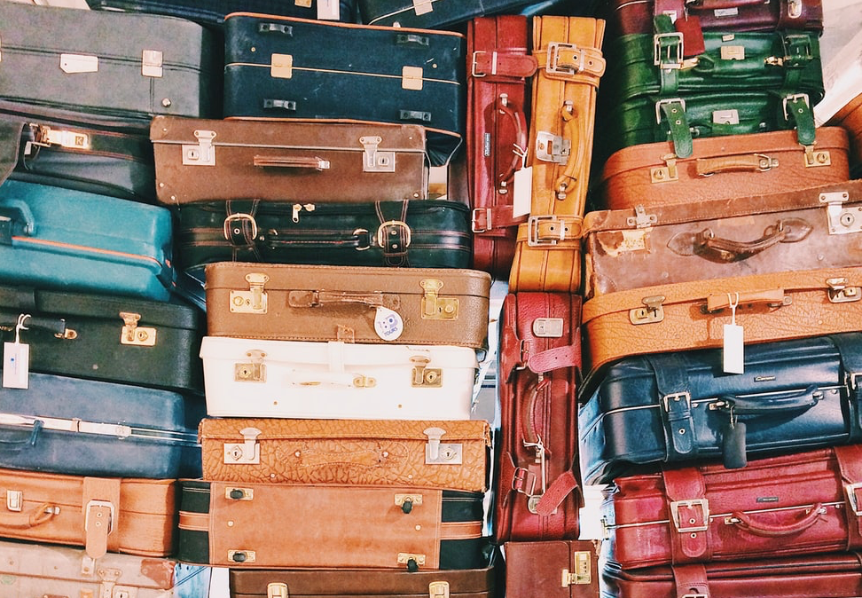 suitcases stacked up on top of each other