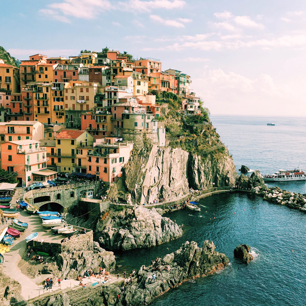 houses on a cliffside in Italy