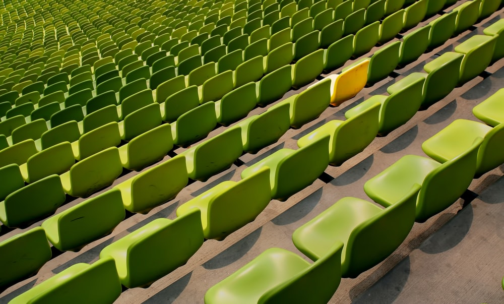 stadium with green seats and one yellow seat