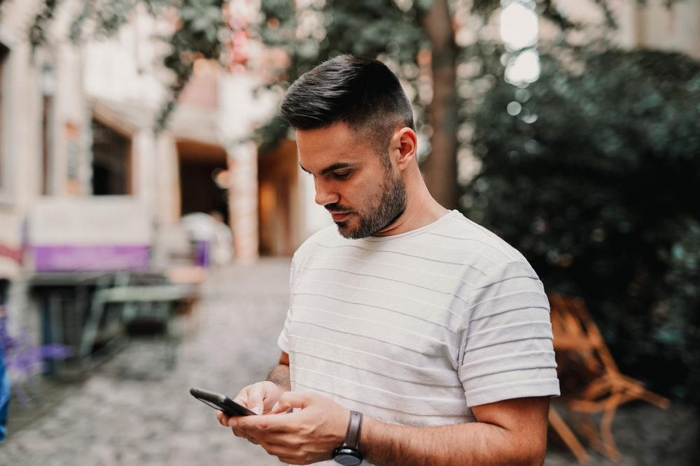 man looking down at his phone