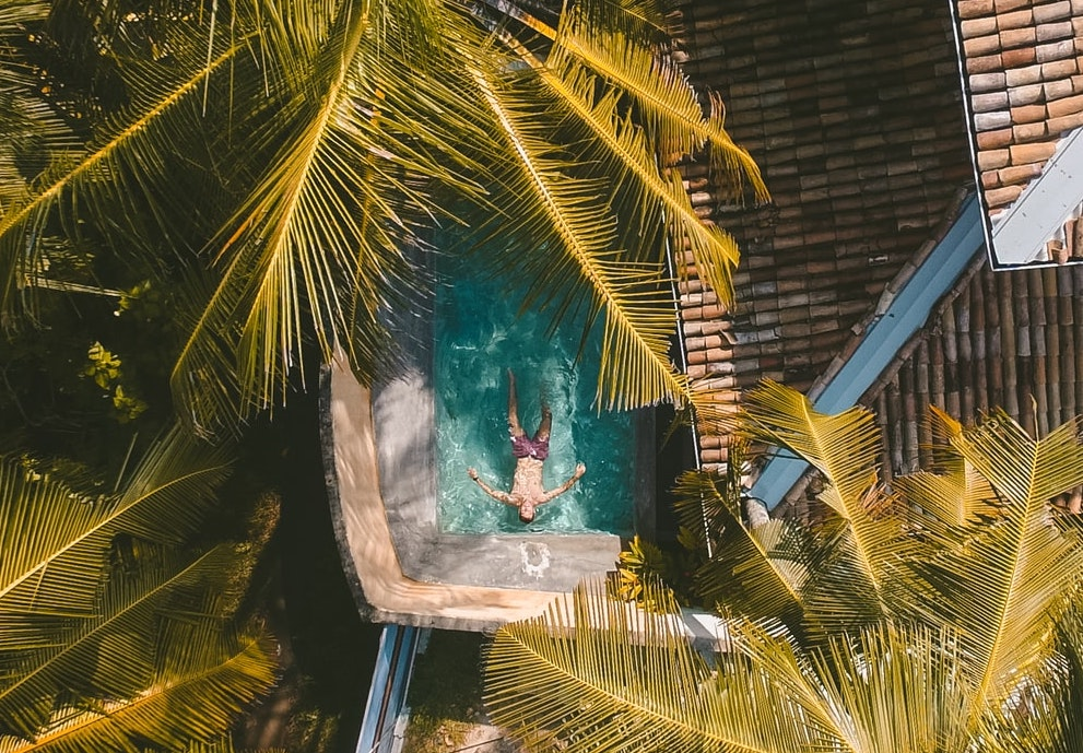 man relaxing in a hotel pool