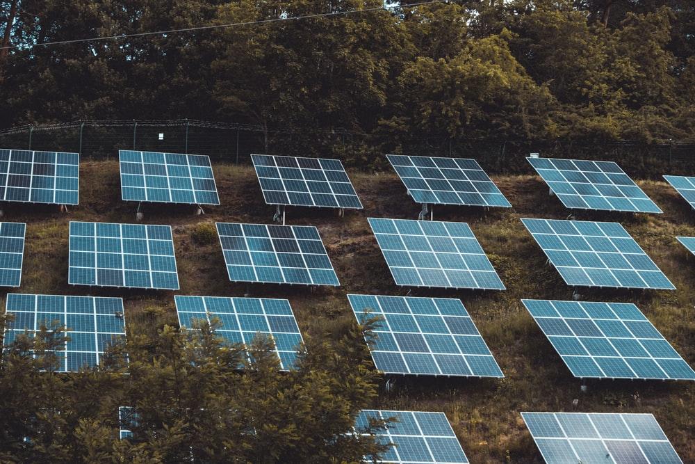 solar panels on a hill