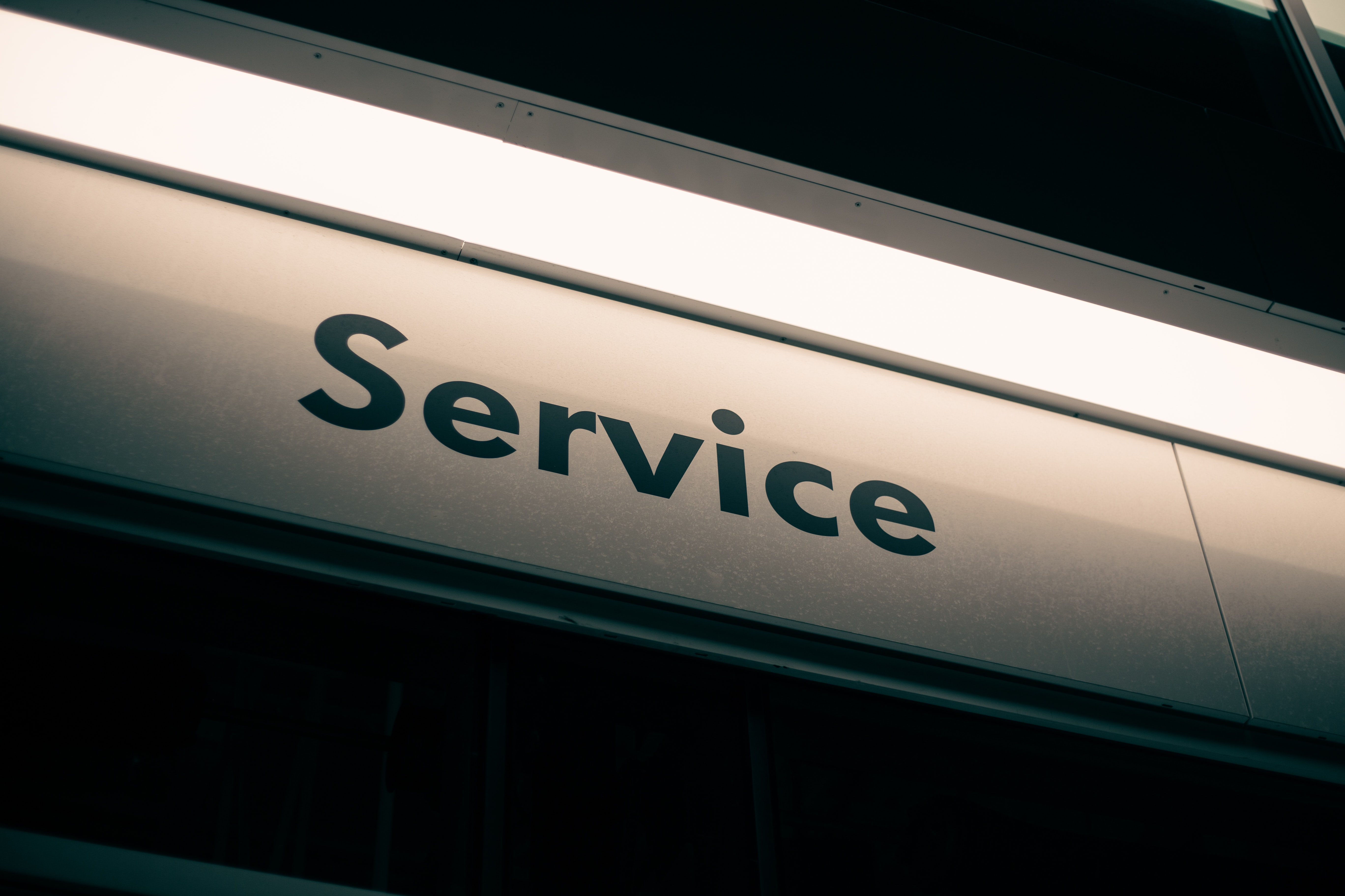 white and black service signage