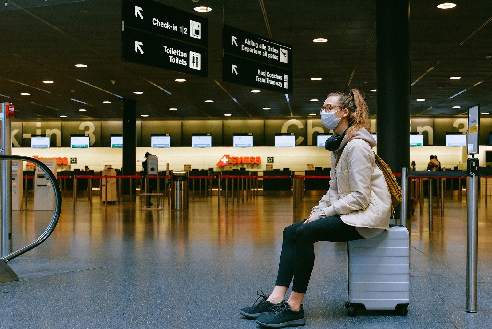 coronavirus masked traveler