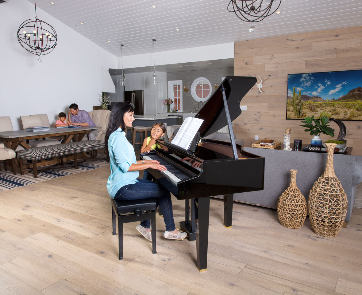Family areound Roland GP-607 Black Grand piano