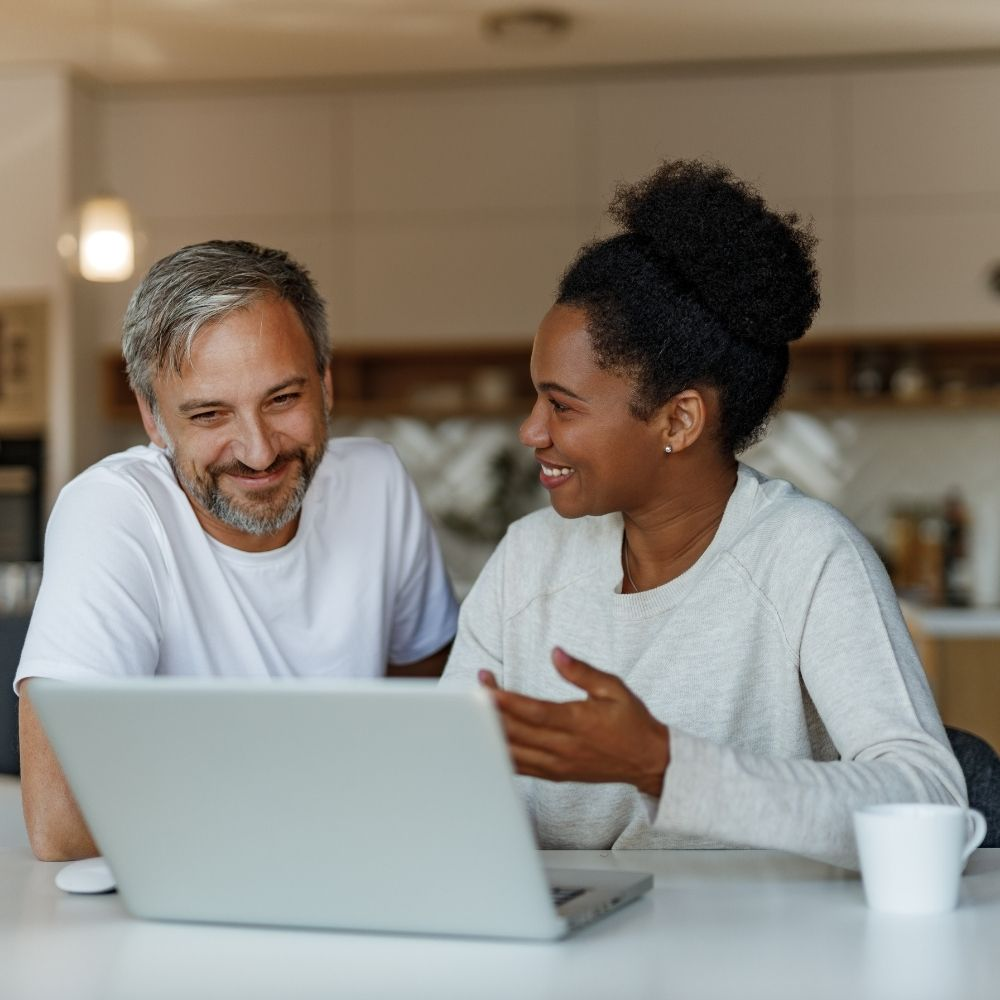 Best Stakeholder Pension Providers - A couple staring at a laptop screen