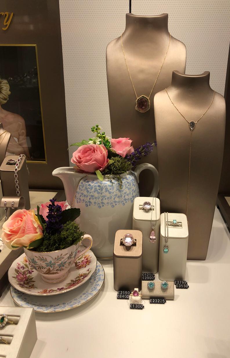 Jewellery store visual merchandising with flowers