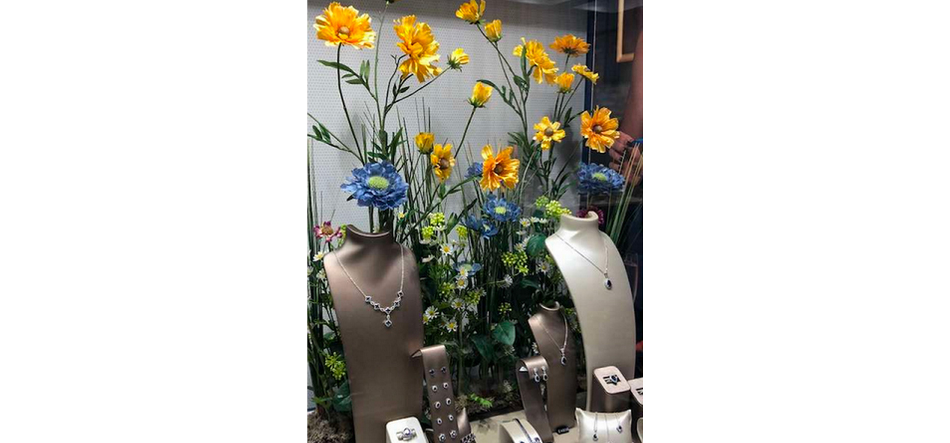 Floral visual merchandising store display for jewellers