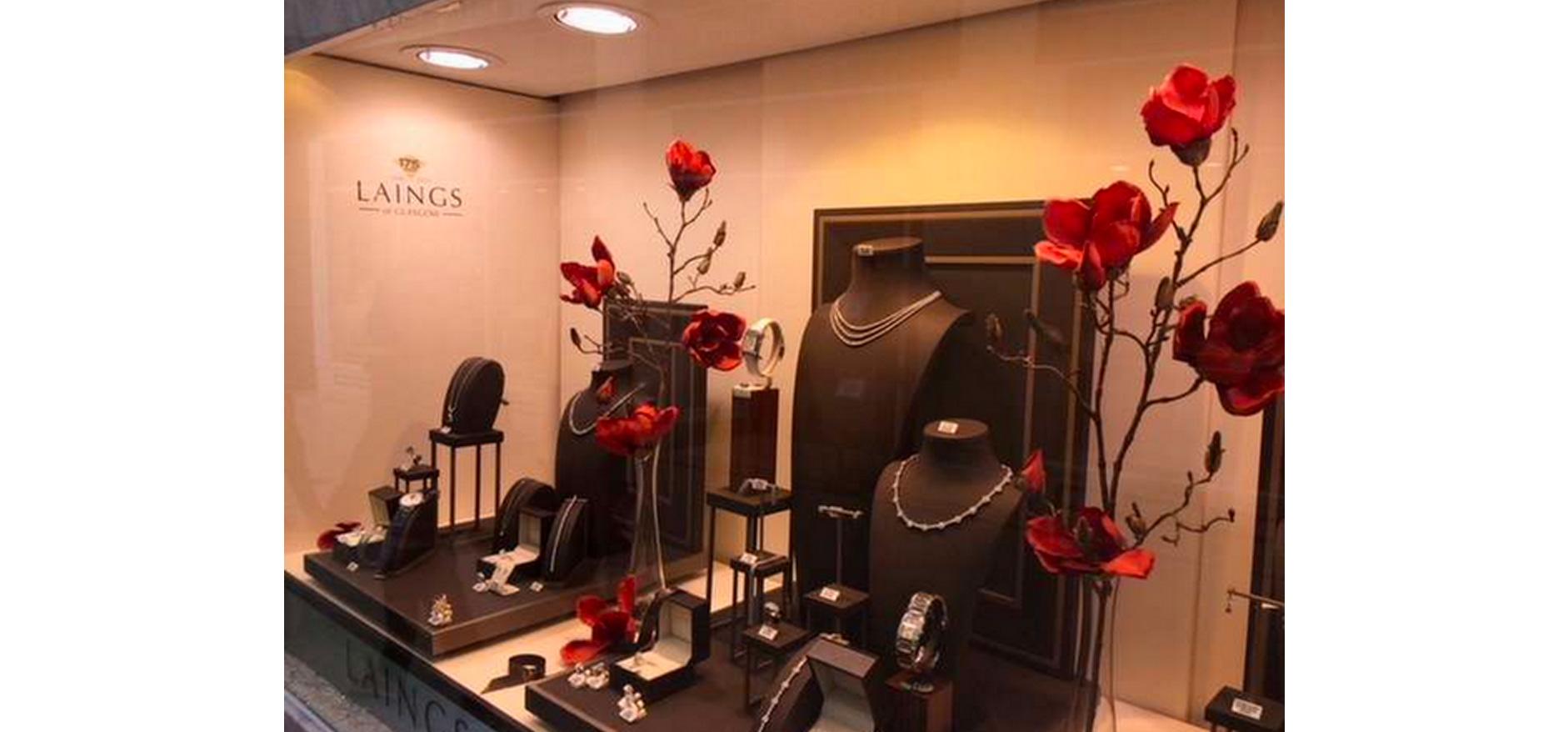 Red rose petal floral visual merchandising for Laings jewellery store