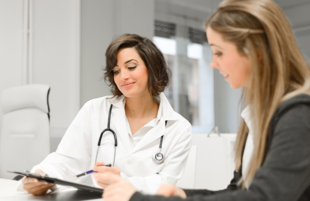 Female doctor speaking to female patient