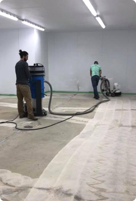 workers grinding floor
