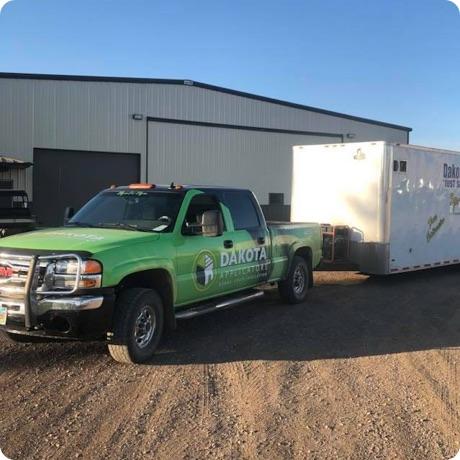 dakota applicators truck pulling a trailer
