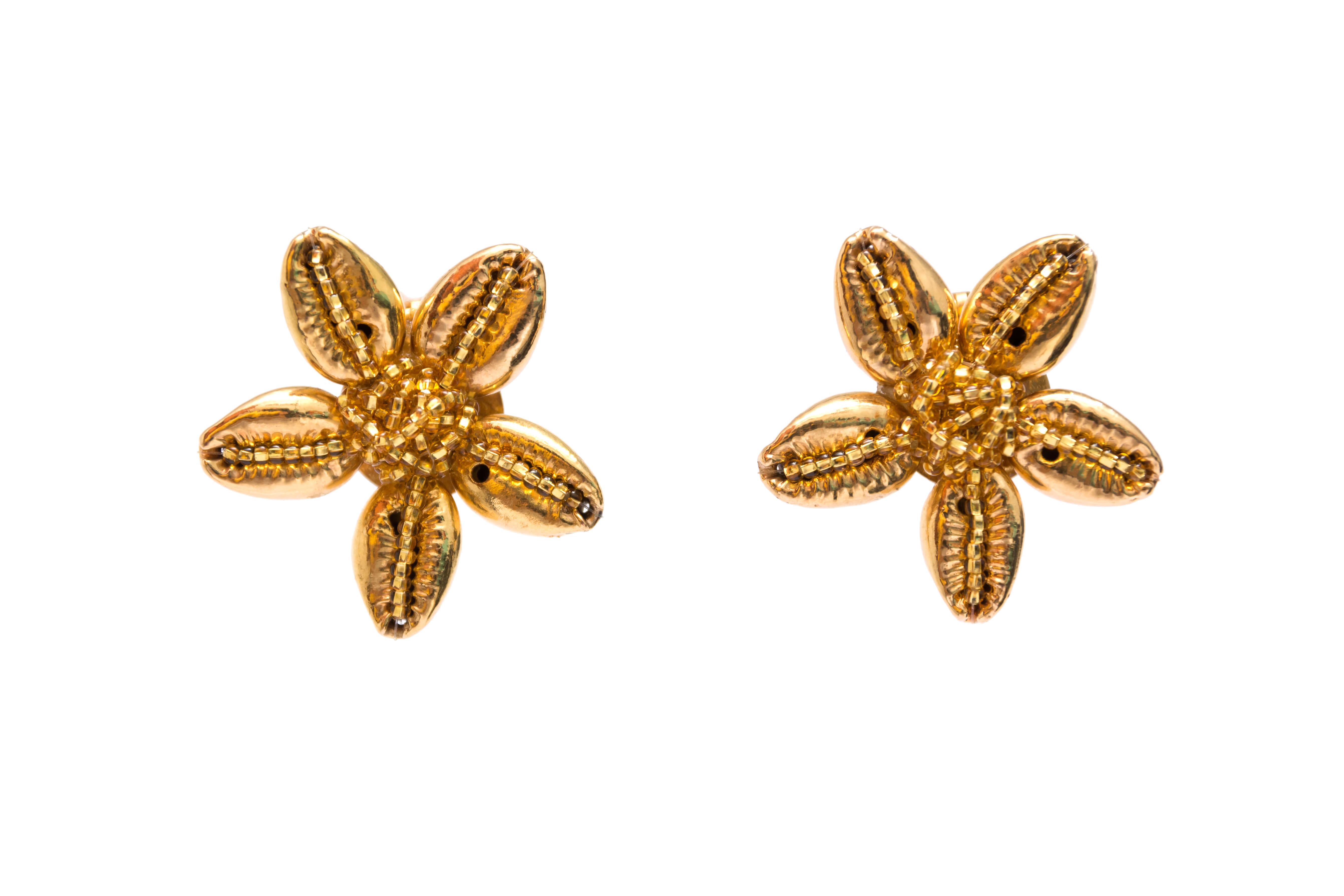 Topos flores de caracol dorados