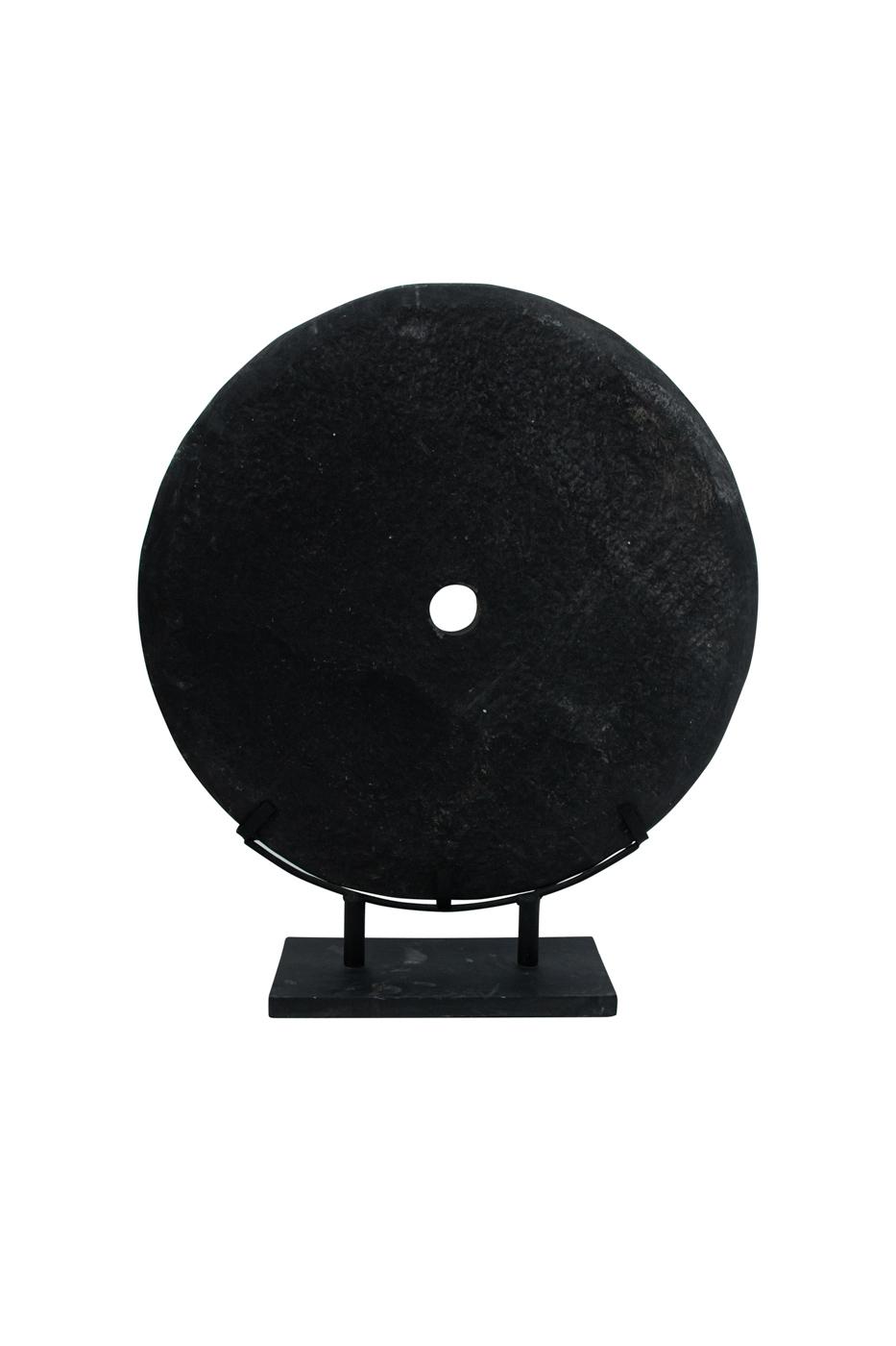 Polished stone on pedestal