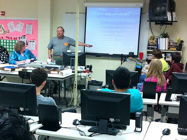 A teacher teaching a class of students