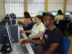 People using the TFA computer lab at our Mission Milby location.