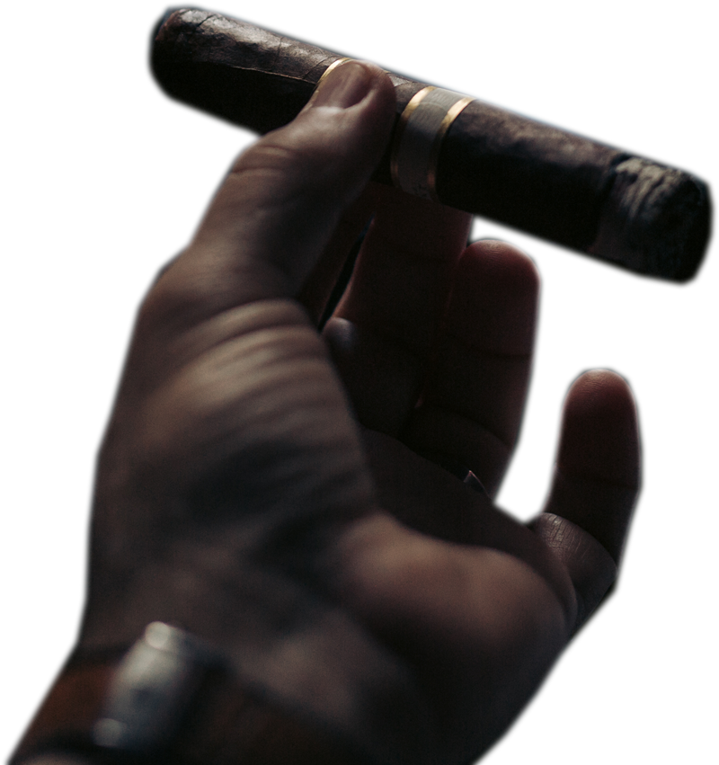 Azarias Mustafa smoking a cigar
